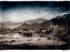 lone-farmhouse-beneath-the-snow-capped-swartberg-mountains-klein-karoo-south-africa-1984_0