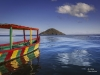 A painted wooden boat in the Chembe Bay at Cape Maclear on the shores of southern Lake Malawi.