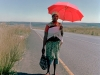 zulu-woman-with-child-on-the-long-road-to-paulpietersburg-1997-south-africa