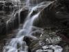 A waterfall tumbles down the mountain on the top of the Transfagarasan Pass in Romanias southern Carpathian Mountains.