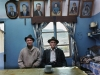 Oom Kosie Farmer and his son Jacobus sit beneath family portraits in their small house in Eksteenfontein.