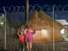 children-with-wood-outside-the-correctional-services-fence-calvina-hantam-karoo-south-africa