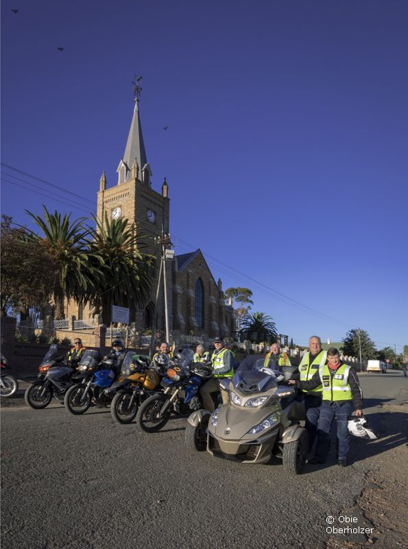 Word Bikers (Bible Society) pose in front of the Uniondale Dutch Reformed Church in Uniondale.