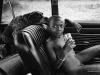 The Zulu boy with coke in the Fiat with Gypsy the dog. KwaZulu-Natal. 1976.
