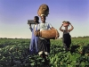 Labourers of the farm Rolvark make toward a Friday evening party in the Limpopo Province of South Africa.