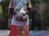 A Zulu woman with chicken walks to market near Melmoth in KwaZuku-Natal.